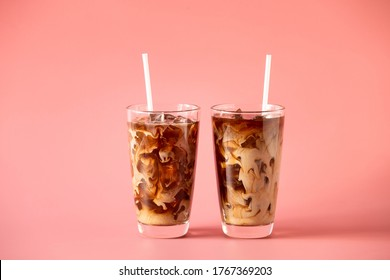Glasses of coffee milk on pink background. Cold beverage tasty. Refreshment food.