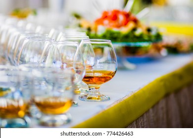 Glasses of cognac stand on the table