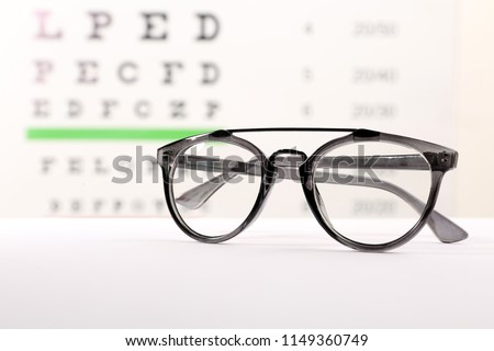 e8a35b44f261 Glasses Corrective Lenses On Table Against Stock Photo (Edit Now ...