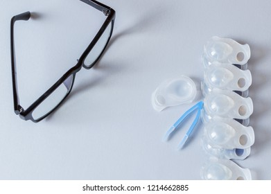 Glasses and daily contact lenses on the grey table, Astigmatism