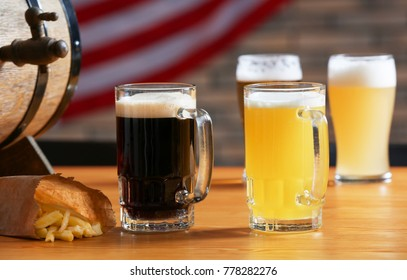 Glasses with dark and light beer on table in sport bar