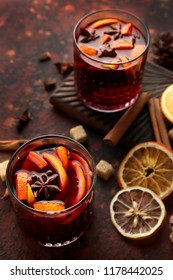 Glasses of delicious mulled wine on color table