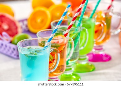 Glasses with different kinds of lemonade on table