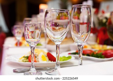 Glasses for drinks and cocktails at the festive table