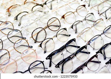 Glasses, Eyeglasses Optical Store, Fashion eyewear at night market, Colorful glasses, Glasses on shelf, Glasses in optical store shopping mall (Selective Focus)