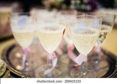 Glasses filled with cold sparkling champagne for wedding reception