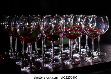 Glasses with a filling for a cocktail on the table