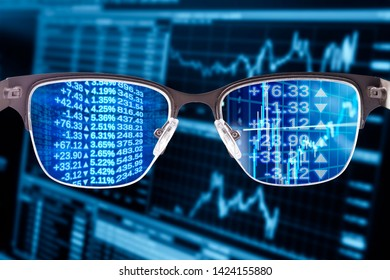 Glasses with financial data and monitor in the background