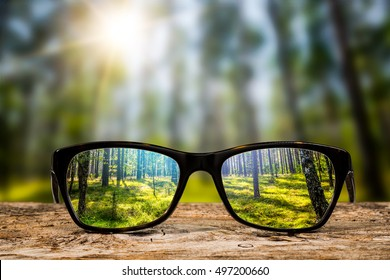 glasses focus background wooden eye vision lens eyeglasses nature reflection look looking through see clear sight concept transparent sunrise prescription sunset vintage sunny sun retro - stock image - Shutterstock ID 497200660
