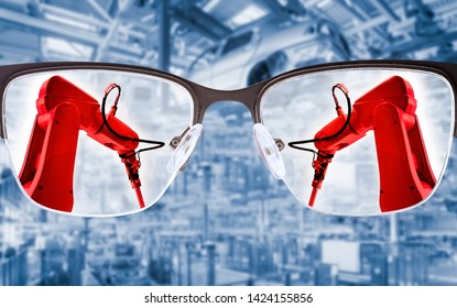 Glasses focus on industrial robots with production hall in the background