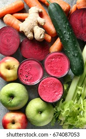 Glasses of fresh beetroot juice with ingredients on metal background.Top view