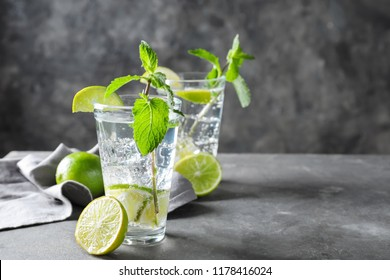 Glasses of fresh mojito on table