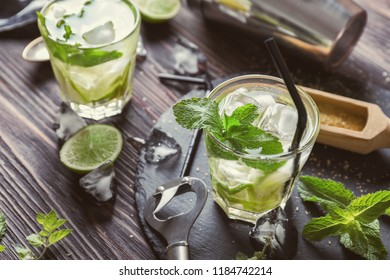 Glasses of fresh mojito on wooden table
