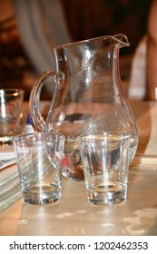 Glasses and glass jar on the table.