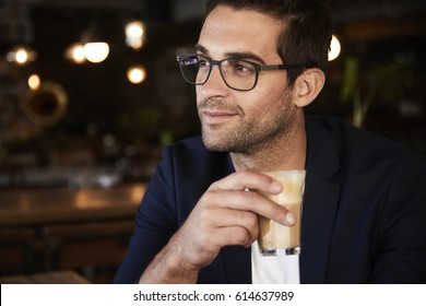 Glasses guy with coffee, smiling