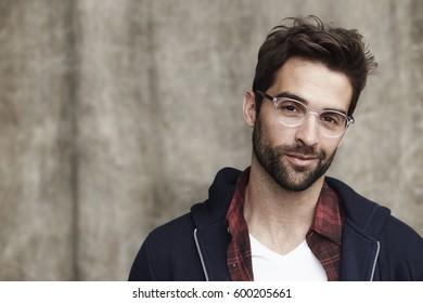 Glasses guy in hoodie, smiling