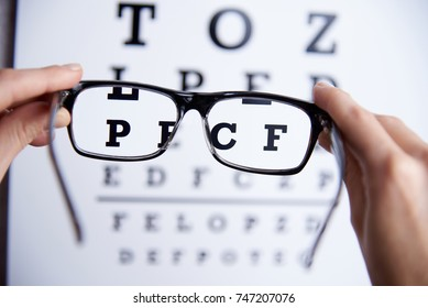 Glasses  in the hands on the background of the table for vision