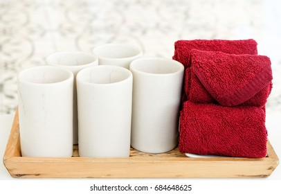 Glasses of herbal drinking and red towels. (welcome drink)