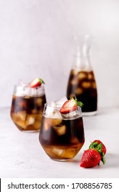 Glasses of Homemade Cold Brew Coffee to Drink for Breakfast Summer Beverage with Ice Cubes Decorated with Strawberry and Chocolate Vertical