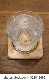 Glasses with ices on wooden table