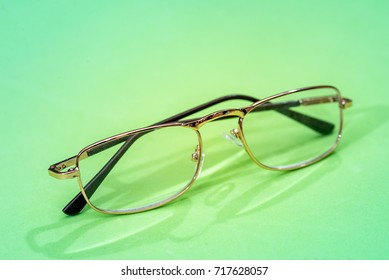 Glasses isolated on green background close up