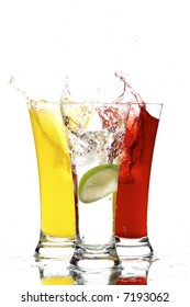 glasses with juice and lemon on the white background
