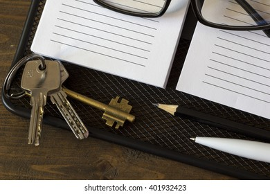 glasses and keys from the house on the notebook top view