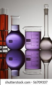 glasses and laboratory flasks with liquid color with white background