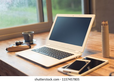 glasses and laptop on the table with nobody, concept of working at home