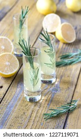 Glasses of limoncello on the wooden background