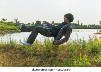 glasses man flying, Float in the park with river background