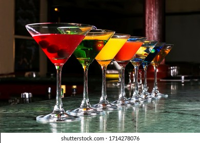 Glasses of martini coctail displayed in a bar counter