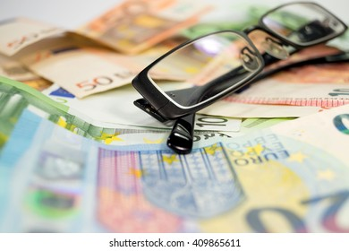 Glasses and money