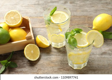 Glasses of natural lemonade with mint on table