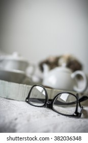 Glasses next to the a tray