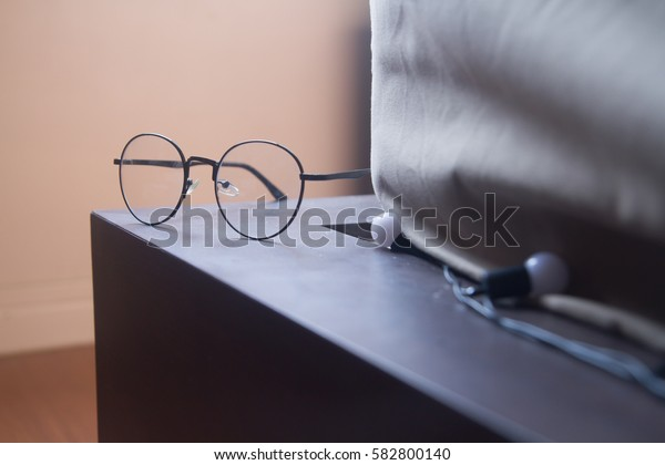 glasses on the bed