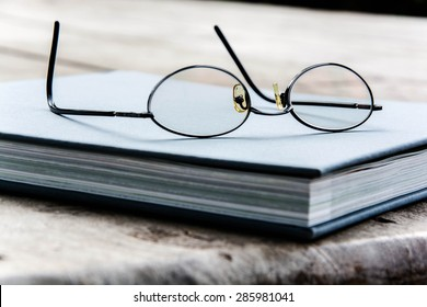 Glasses on a blue book