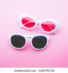 Glasses on color pastel background.holiday concept idea