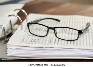 Glasses on a file folder in an office