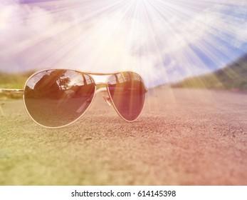 glasses on floor light sunshie nature