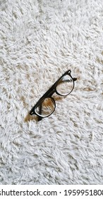 Glasses on a fur rug - Shutterstock ID 1959951808