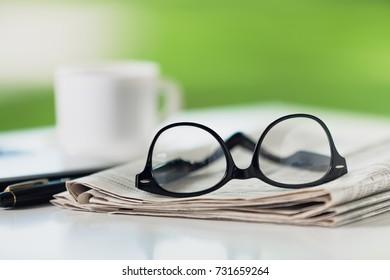 Glasses on newspaper.