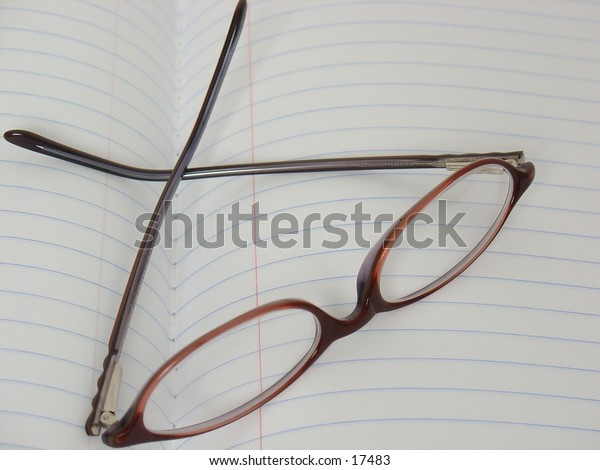 Glasses on Notebook Paper
