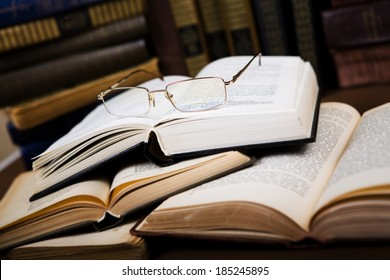 glasses on the open book in the library