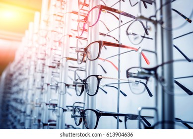 Glasses on the shelf. Ophthalmology room. Background