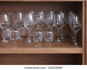 Glasses on a shelf in a restaurant.