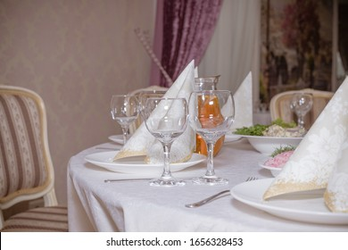 Glasses on the table. Festive table setting. Wedding decor. Table setting in fine art style. Cafe decor. Catering wedding ceremony, selective focus.crystal glasses on the festive table.linen napkins - Shutterstock ID 1656328453