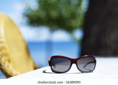 Glasses on the table in tropics background