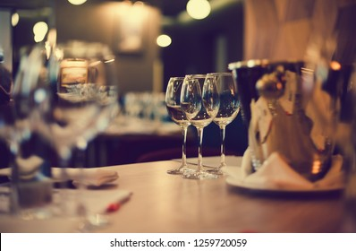 Glasses on the table for wine tasting. Selective focus