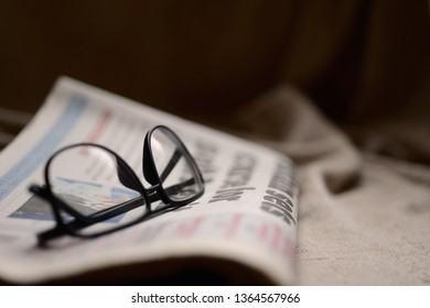 Glasses on top of a newspaper with copyspace